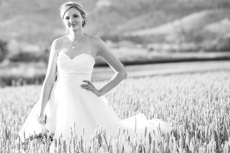 gorgeous bride in field of tall grass