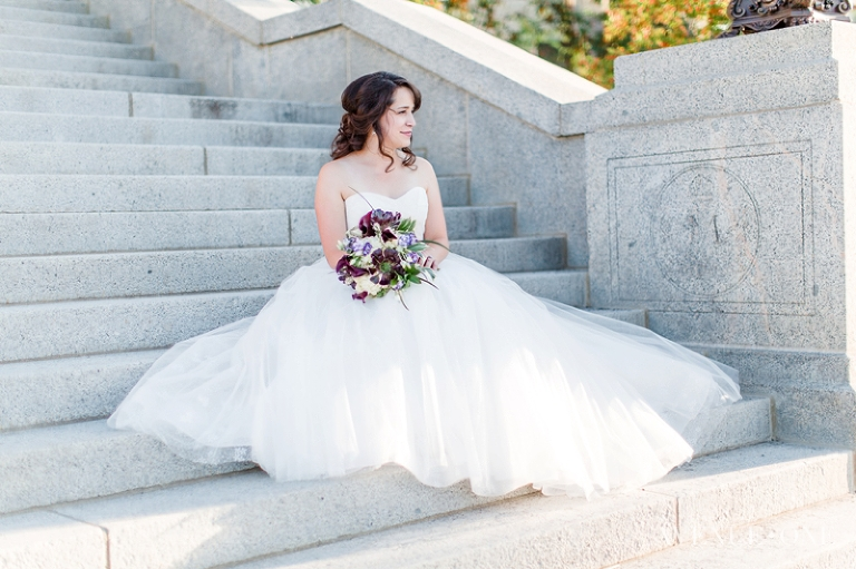 bride looking into the distance on steps